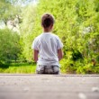 Portrait of a little boy in forest — Stock Photo #46770047