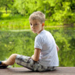 Portrait of a little boy in forest — Stock Photo #50568111
