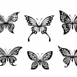 Black butterfly tattoos and silhouettes — Stok Vektör