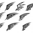 Set of black tribal wing tattoos — Stock Vector #15344467