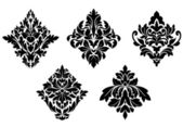 Set of vintage floral patterns and embellishments — Stock Vector