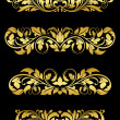 Golden floral embellishments — Stock Vector