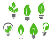 Light bulbs with green leaves — Stock Vector