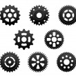 Pinions and gears set — Stock Vector #24625565