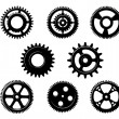 Set of metallic pinions and gears — Stock Vector