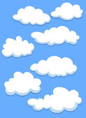 Cartoon white clouds on sky — Stock Vector