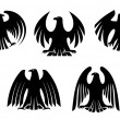 Stock Vector: Black heraldic eagles