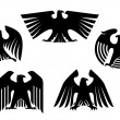Majestic and powerful heraldic eagles — Stock Vector