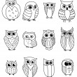 Cartoon owls and owlets — Stockvectorbeeld