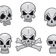 Cartoon skulls set — Stock Vector