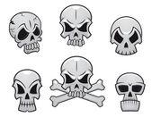 Cartoon skulls set — Stock Vector