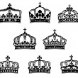 Stock Vector: King and queen heraldic crowns set