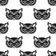 Seamless pattern with black owl head — Stock Vector