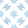 Seamless background with blue snowflakes — Stock Vector