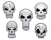 Cartoon skulls set with danger emotions — 图库矢量图片