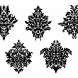 Set of five different foliate arabesques — Stock Vector