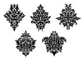 Set of five different foliate arabesques — Vecteur