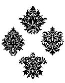 Four different foliate arabesque motifs — Stock Vector