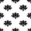 Stock Vector: Black silhouette foliate motif in seamless pattern