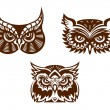 Collection of wise old owl faces — Stock Vector #41461381