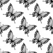 Seamless pattern of flying butterflies — Stock Vector #41888773