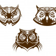 Owl heads mascots — Stock Vector #43647725