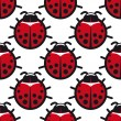 Seamless background pattern of ladybugs — Stock Vector