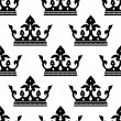 Seamless pattern of a royal crown silhouettes — Stock Vector