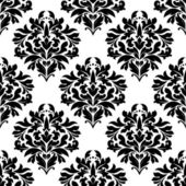 Arabesque seamless pattern with floral motifs — Stock Vector