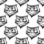 Seamless pattern of the head of a fierce owl — Stock Vector