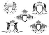 Set of heraldic winged shields — Vector de stock