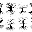 Bare tree silhouettes with roots — Stock Vector #51075791
