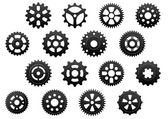 Gears and pinions silhouettes set — Stock Vector