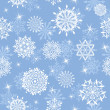 Seamless snowflakes background — Stockvectorbeeld