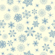 Seamless snowflakes background — Stock Vector #12236141