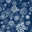 Seamless snowflakes background — Stock Vector #12334231