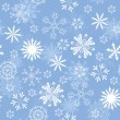 Seamless snowflakes background — Stock Vector #12334242