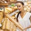Woman choose Fresh baked bread — Stock Photo