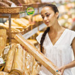 Woman choose Fresh baked bread - Stock Photo