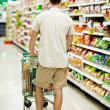 Stock Photo: Mpushing shopping trolley