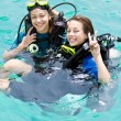 Stock Photo: Portrait of two attractive friends going scubdiving
