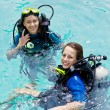 Stock Photo: Portrait of two attractive friends going scuba diving