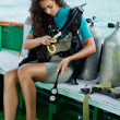 Beautiful woman checking diving. dive equipment - Stock Photo