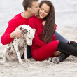 Romantic couple with a dog — Stock Photo #24039873