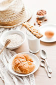 Healthy breakfast: croissant, porridge, almonds and milk — Zdjęcie stockowe