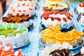 Colorful beautiful cake with fruits and chocolate — Stock Photo