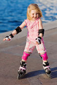 Little pretty girl riding a roller — Stock Photo
