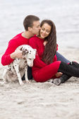 Romantic couple with a dog — Stock Photo