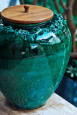 Ceramic vase decorating city garden — Stock Photo