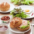 Breakfast with hamburger, tea, egg and green salad — Stock Photo